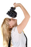 Girl with grapes cluster Royalty Free Stock Photo