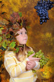 The girl with grapes in hands Stock Image