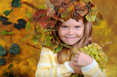 The girl with grapes in hands Royalty Free Stock Photos