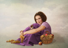 The girl with grapes Stock Image
