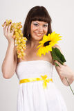 Girl with grapes and sunflower Royalty Free Stock Image