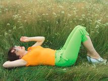 Girl on grass Royalty Free Stock Images