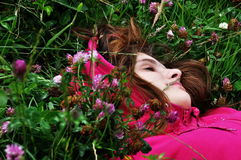 Girl in grass. Girl sleeping in grass with closed eyes Stock Images