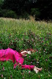 Girl in grass. Girl sleeping in grass with closed eyes Royalty Free Stock Photography