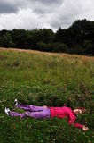 Girl in grass. Girl sleeping in grass with closed eyes Stock Photo