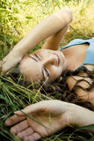 Girl on the grass. Girl is lying on the grass Royalty Free Stock Images