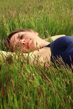 Girl in grass Stock Photography