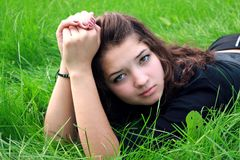 Girl on grass. Stock Photography