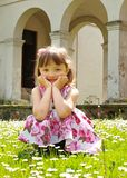 Girl on the grass. Pretty young girl on the daisy flower grass Royalty Free Stock Image