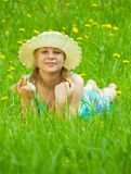 Girl in grass Stock Images