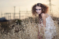 The girl in a grass Royalty Free Stock Images