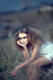 The girl in a grass Stock Photo