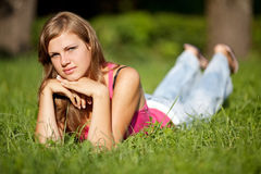 Girl on grass Stock Images