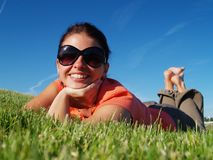 The girl on a grass. Happy smile Stock Photo