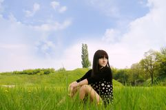 Girl  on  grass Royalty Free Stock Photo
