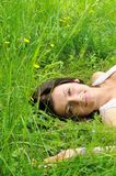Girl on grass Stock Image