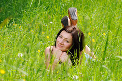 Girl on grass Royalty Free Stock Image