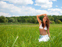 Girl in grass Stock Image