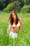 Girl in grass Stock Photos