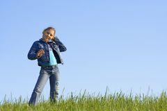 Girl on the grass Stock Photography