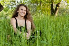 Girl in the grass Royalty Free Stock Photography