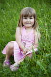 Girl in the grass Stock Photography