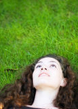 Girl on the grass Stock Photos