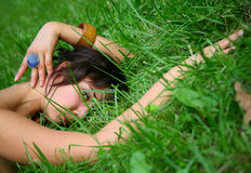 Girl in a grass Stock Photo