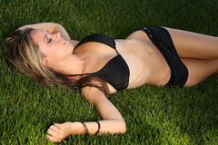 Girl in the grass Stock Photo