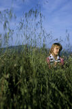 Girl in Grass Royalty Free Stock Image