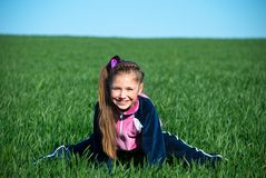 Girl on a grass Royalty Free Stock Images