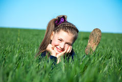 Girl on a grass Royalty Free Stock Photography