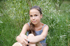 Girl on grass background Royalty Free Stock Image