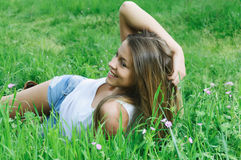 Girl in the grass Royalty Free Stock Image