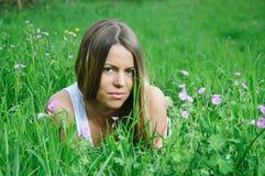 Girl in the grass Stock Photos