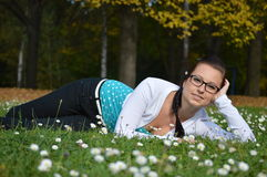 Girl on the grass Stock Image