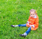 Girl on grass with dandelion Royalty Free Stock Images