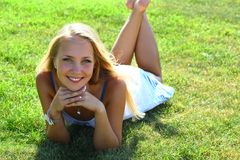 Girl on grass field Stock Image
