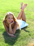 Girl on grass field Royalty Free Stock Photo