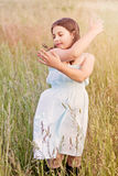 Girl in grass - freedom Royalty Free Stock Photography