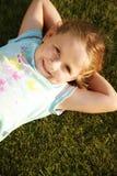 girl grass happy relaxing Стоковое Изображение