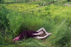 Girl in the grass stock image