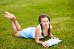 Girl on the grass Stock Photos