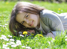 Girl  in the grass Stock Images