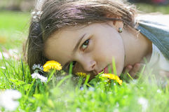 Girl  in the grass Royalty Free Stock Photos