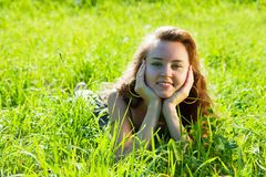 Girl  in grass at meadow Stock Images