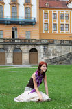 Girl at grass near castle. In Germany Stock Photo