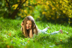 Girl on grass in park Stock Photography