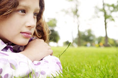 Girl on grass in park. Stock Photography