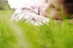 Girl on grass in park. Royalty Free Stock Photos